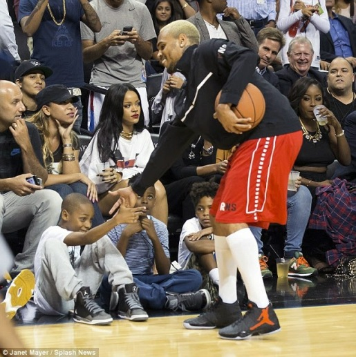 Rihanna watches Chris Brown play at Charity basketball game