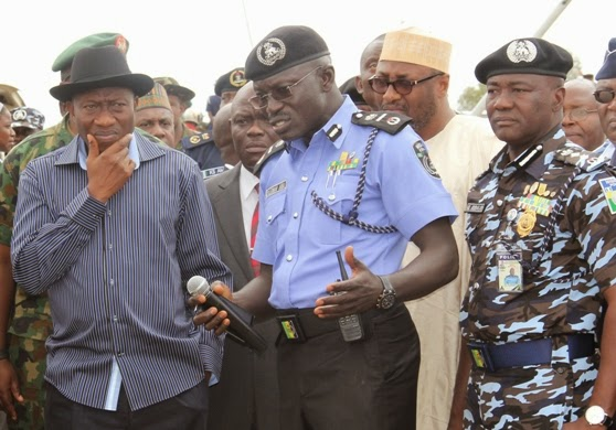 ''Soldier go, Soldier come! Pres. Jonathan left, Suleiman Abba and the outgoing IG of police, Mohammed Abubakar