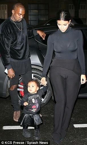 Who rocked: Kim Kardashian, Kanye West and North West at Balenciaga show in Paris