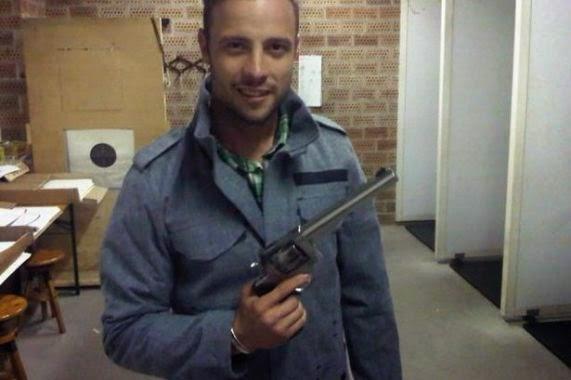 Oscar Pistorius with gun - ozara gossip